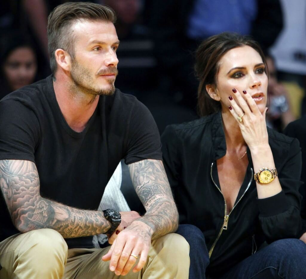 David and Victoria Beckham both sporting their Rolex's at a sporting event.