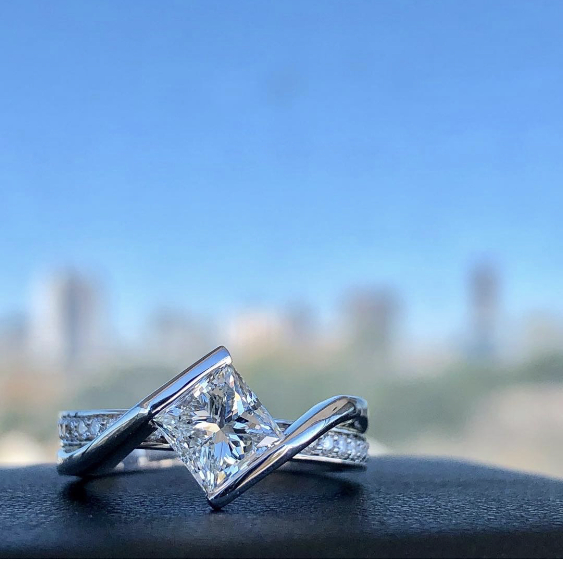 custom engagement ring using an asscher cut loose diamond from our Houston inventory